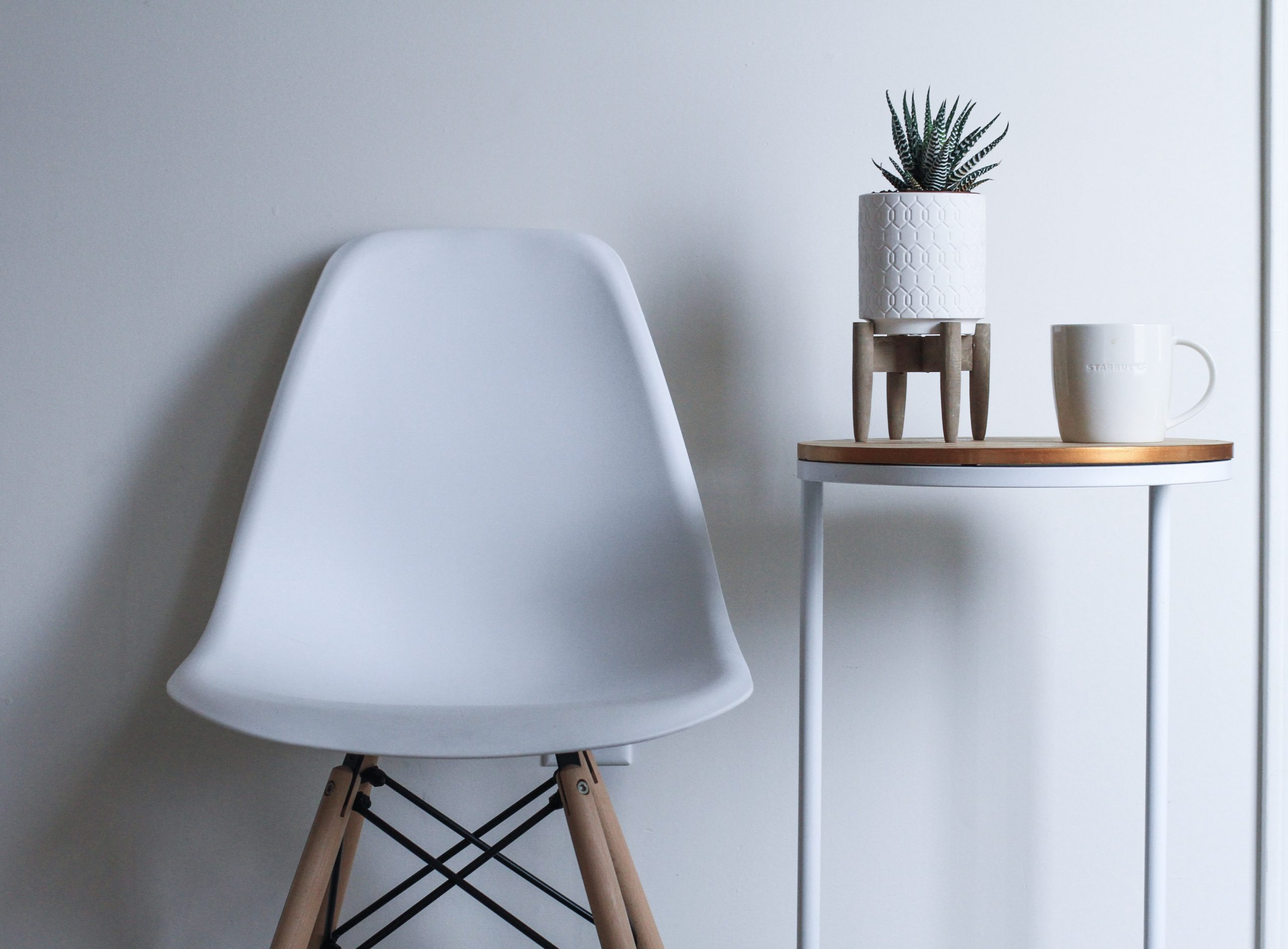 White chair and plant